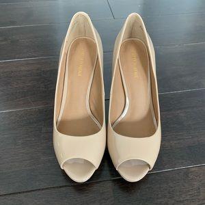 Nude open toed pumps